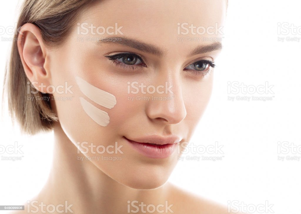 Skin tone cream lines on woman face. Beautiful woman portrait beauty skin healthy and perfect makeup – zdjęcie