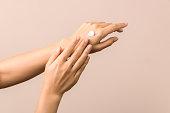 skincare. close up view of woman hand moisturising them with cream. skincare.
