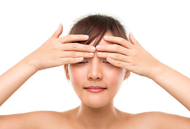 Skincare woman putting eye cream stock photo