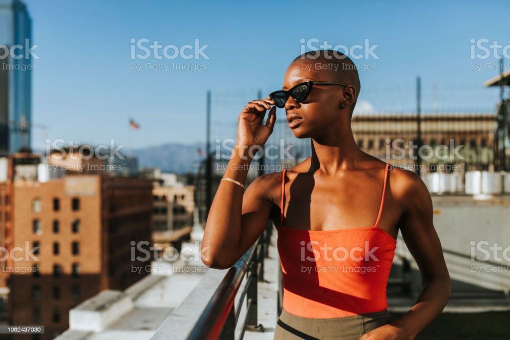 Skinhead girl at a LA rooftop stock photo