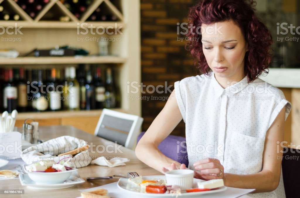 skinny anorexic girl or woman rejects food in restaurant stock photo
