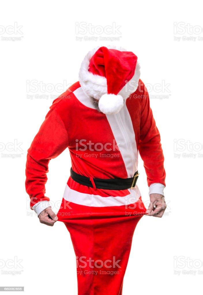Skinny Santa Claus Stretching His Santa Pajama Coveralls stock photo