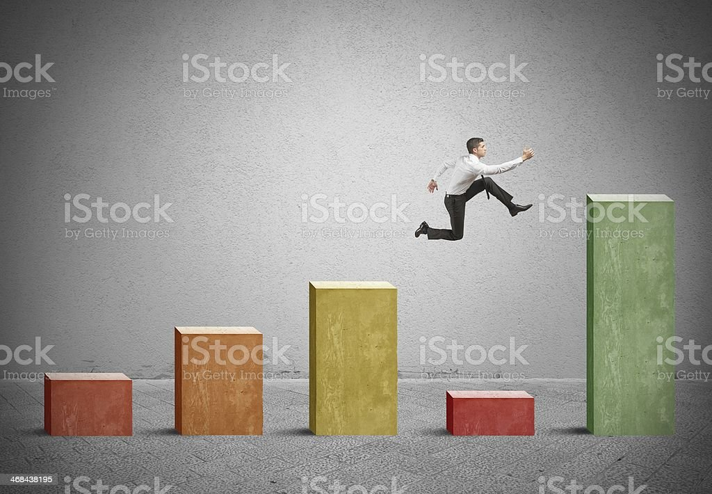 Skip the problem Businessman skips the crisis with a jump on a positive statistic Adult Stock Photo