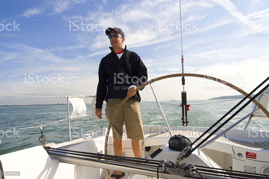 Skipper At The Wheel of A Yacht or Sailing Boat royalty-free stock photo