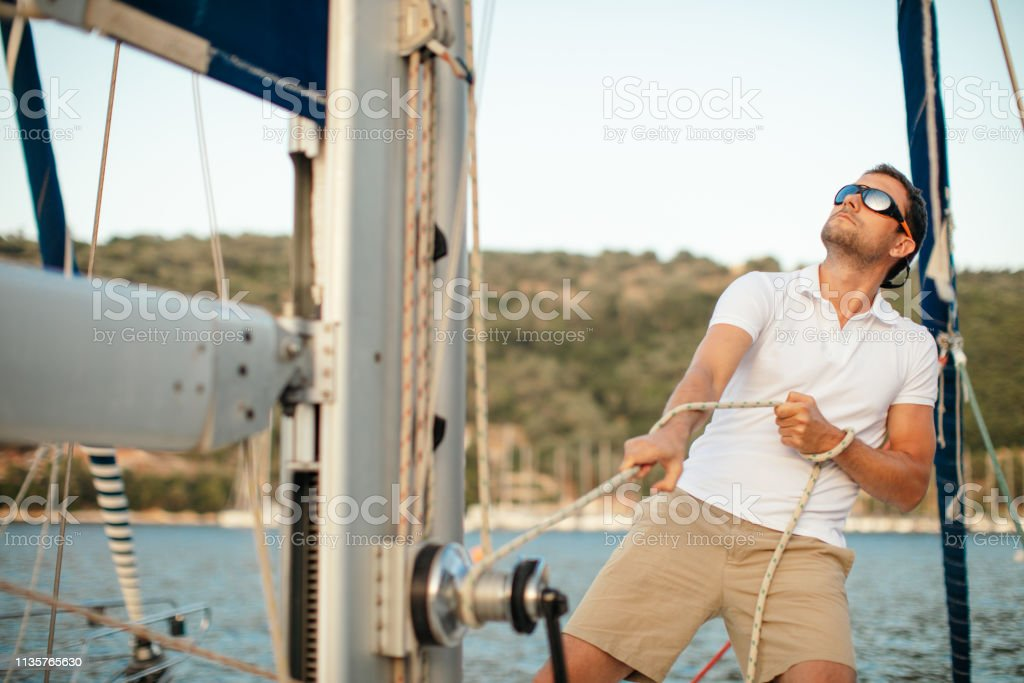 Skipper of the sailboat stock photo