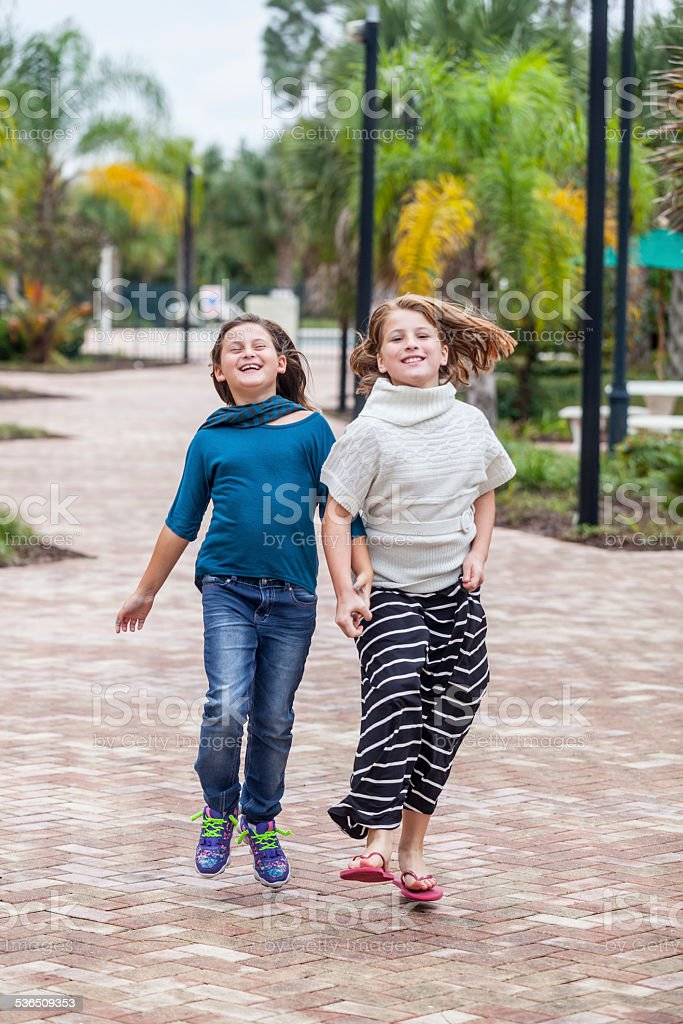 Skipping and Running with my Big Sister stock photo