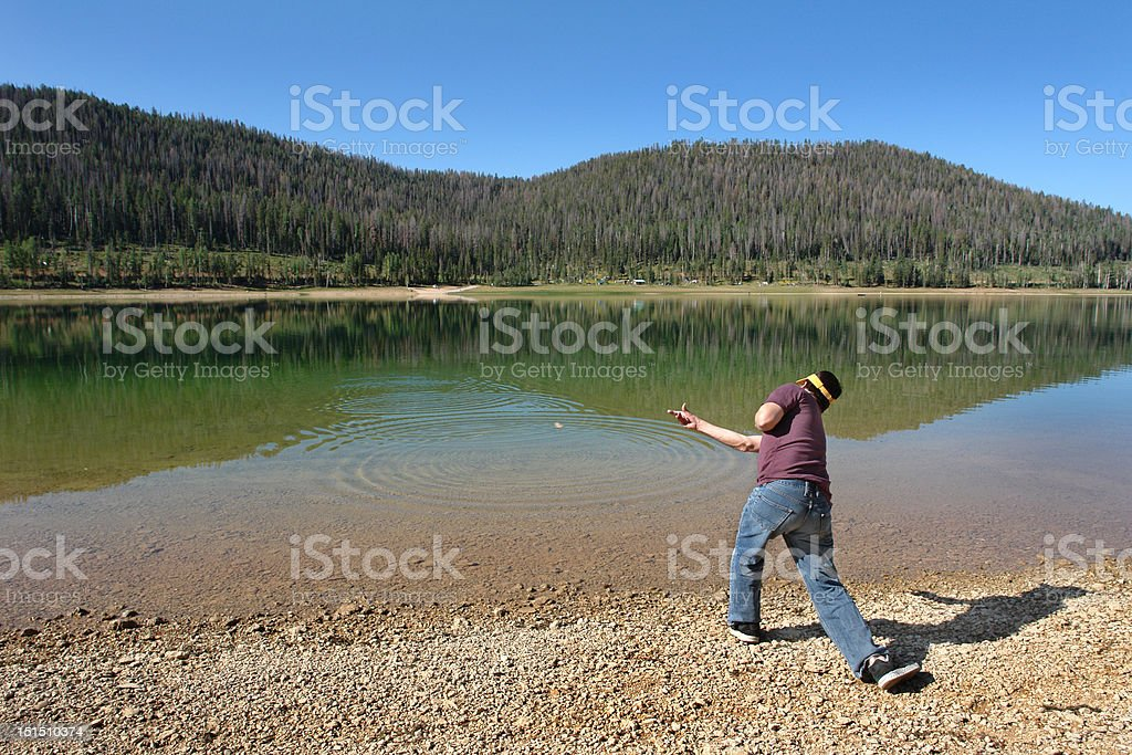 skipping rocks stock photo