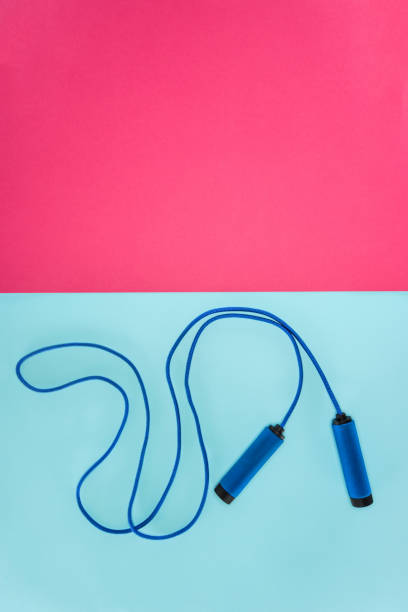 Skipping rope isolated on pink and blue stock photo