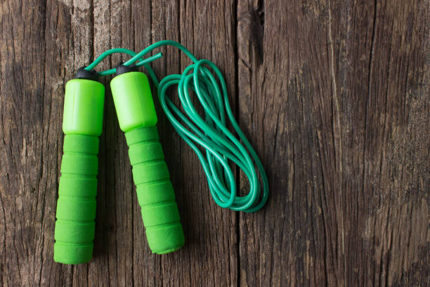 skipping rope on old wooden stock photo