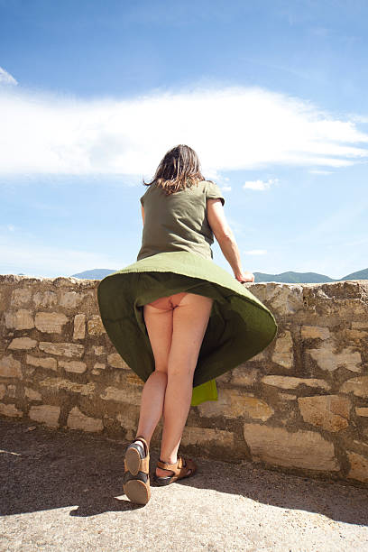 skirt blown by wind - buttock stock photos and pictures