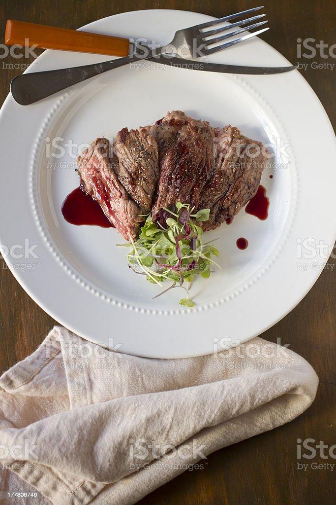 Skirt Steak with Pomegranate Gastrique stock photo