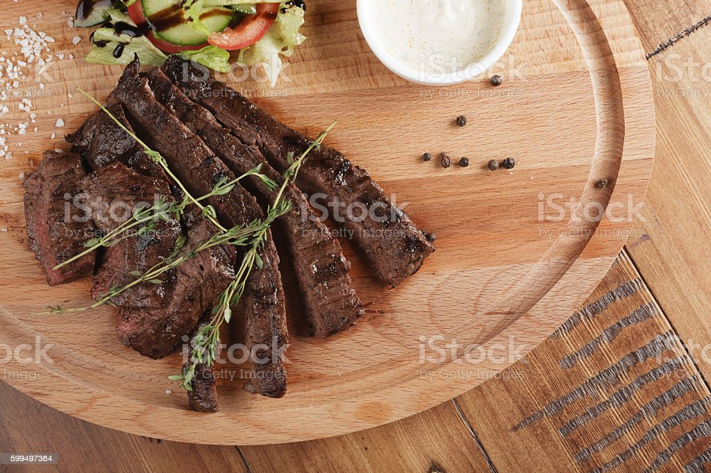 Skirt steak with salad stock photo