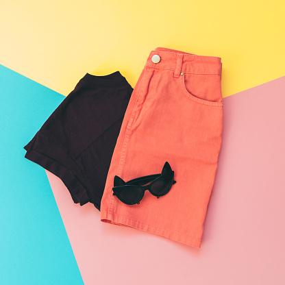 640200626 istock photo skirt, t-shirt and sunglasses 914751326