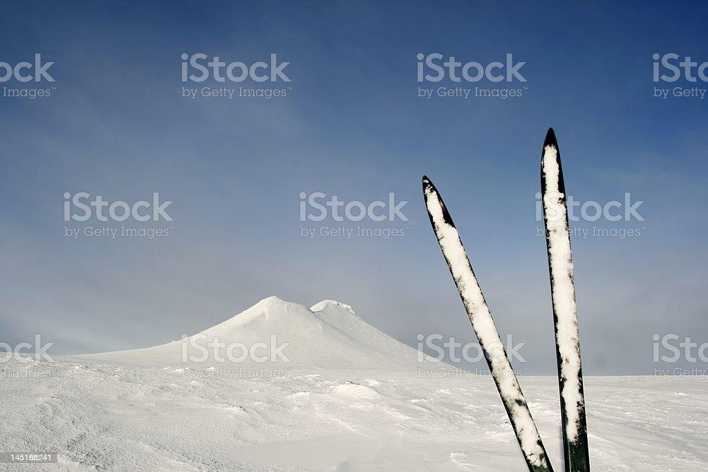 Skis and Mt. Stadjan stock photo