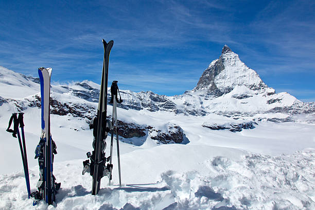 Skis and the Matterhorn A pair of skis against the Matterhorn, taken in the resort of Zermatt, Switzerland. zermatt stock pictures, royalty-free photos & images