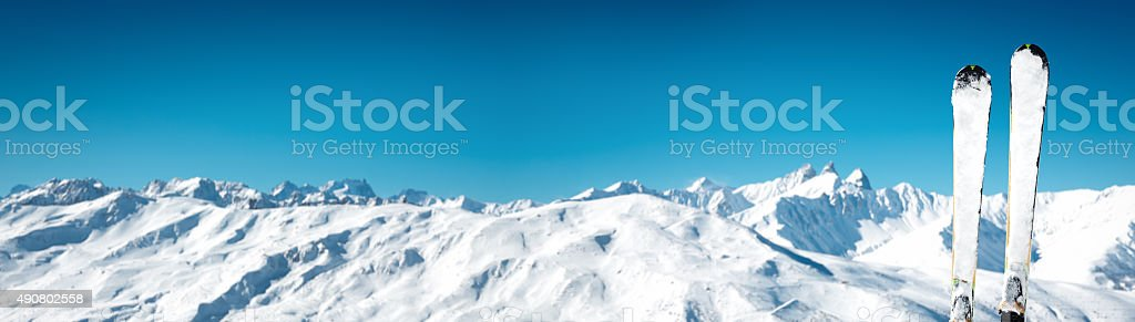 Skis In Front Of Idyllic Mountain Range stock photo