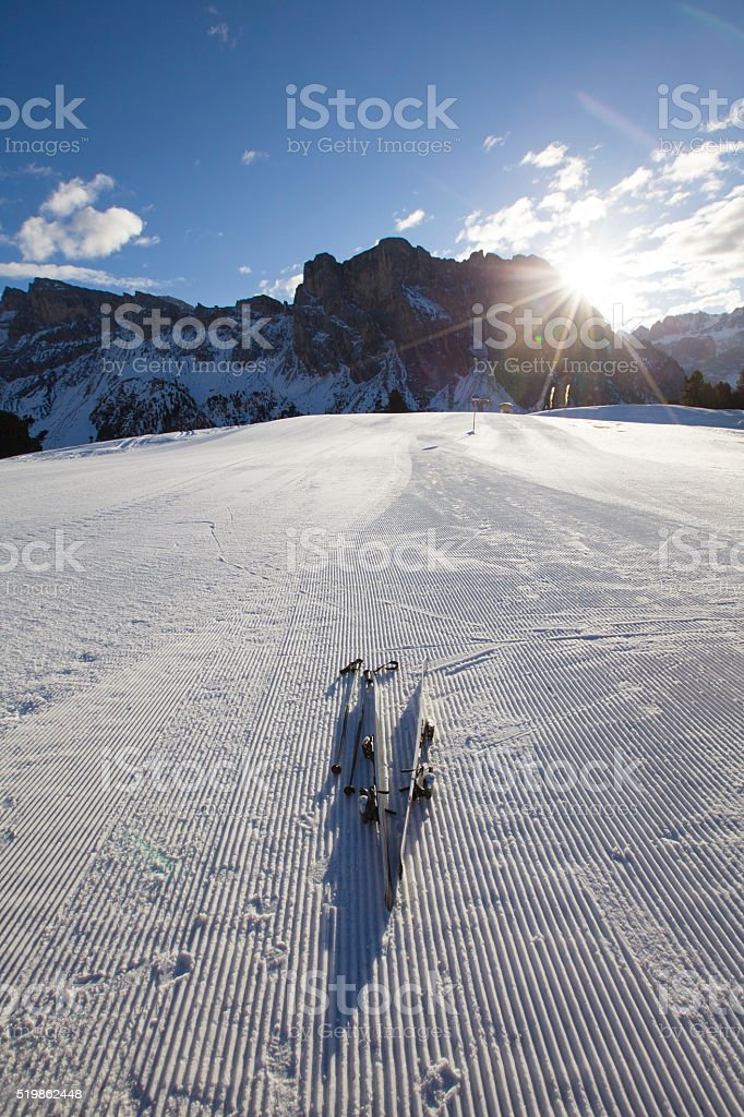 Skis on the skiing slope in Dolomites, Italy stock photo
