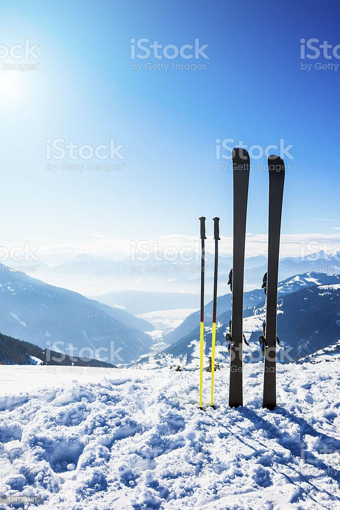Skis on top of slope against sun royalty-free stock photo