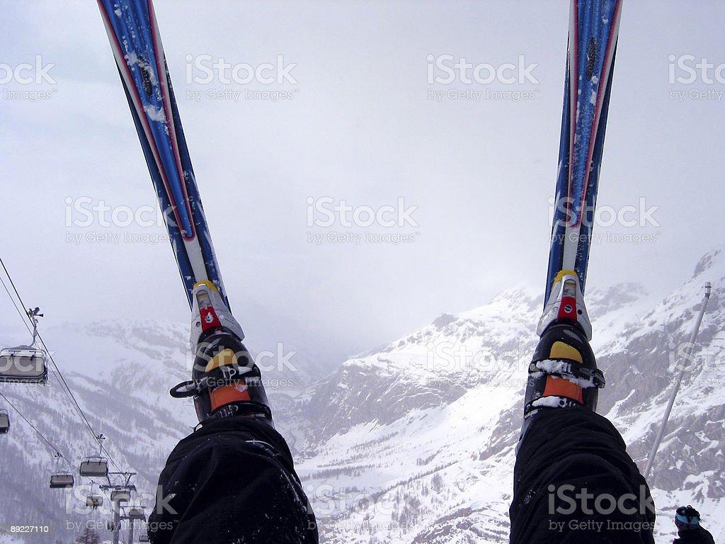 Skis over foggy Alps stock photo