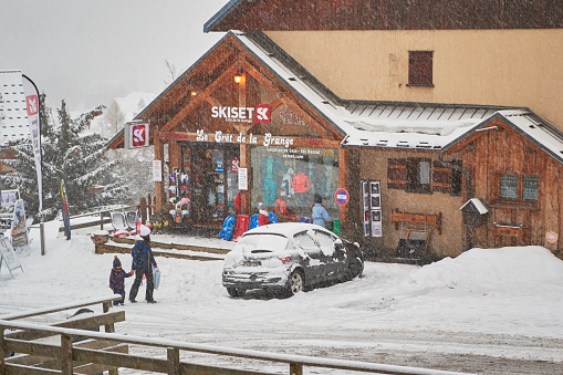 Skiset rental shop in Saint-Jean-d Arves village, Les Sybelles ski domain, during a snowy day, late Spring.