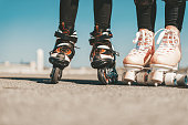 legs of two  girls on roller skates on Tempelhofer Feld in Berlin