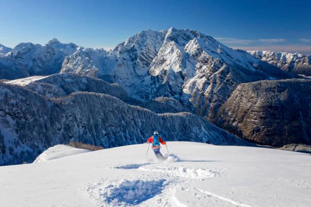 Skitouring downhill - powder skiing at Watzmann - Nationalpark Berchtesgaden stock photo