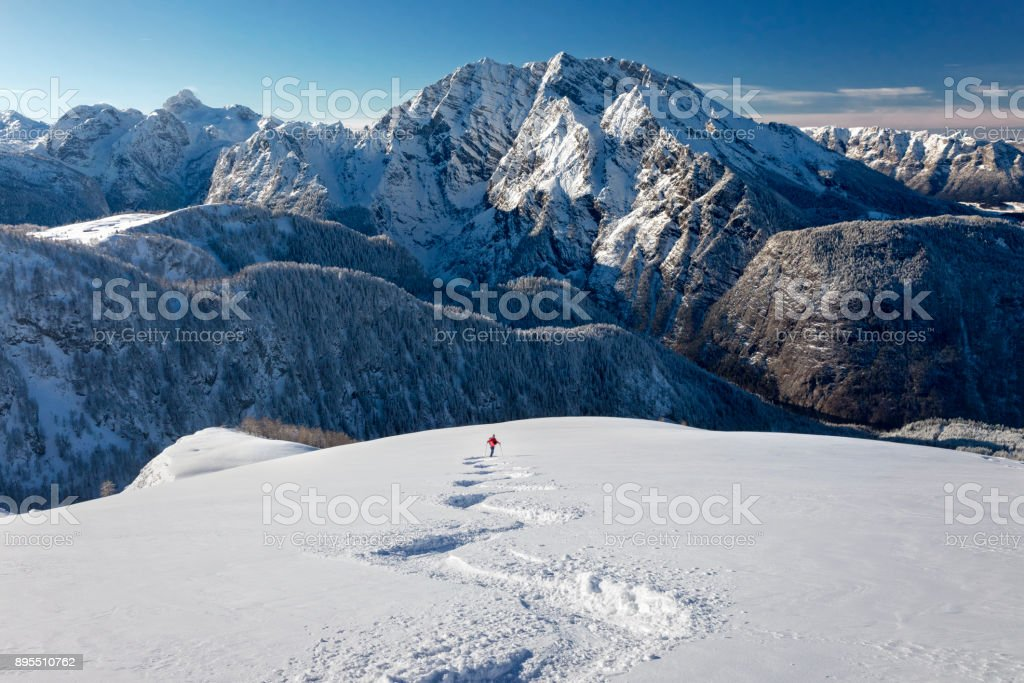 Skitouring downhill - powder skiing at Watzmann - Nationalpark Berchtesgaden stock photo