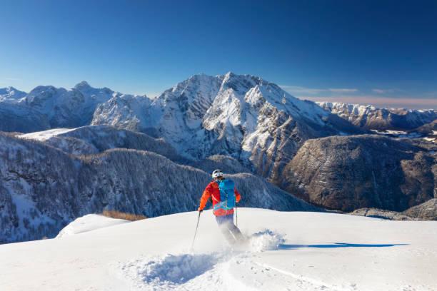 Skitouring downhill powder skiing at watzmann nationalpark picture id895600056?b=1&k=6&m=895600056&s=612x612&w=0&h=mnjffktu0 mqd1hn2bjhsszb2ne9entrgvrsmgseuqe=