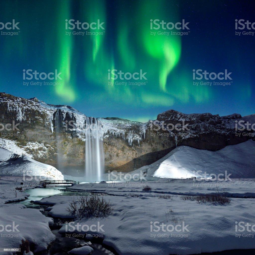 Skogafoss Waterfall and Green Aurora, Iceland stock photo