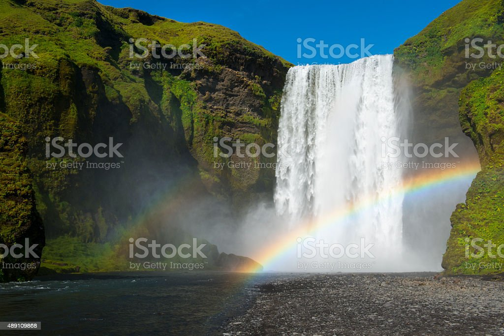 Skogafoss waterfall with double rainbow at perfect sunny day stock photo