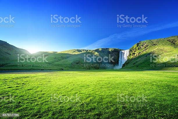 Photo of Skogarfoss waterfall and summer sunny day, Iceland