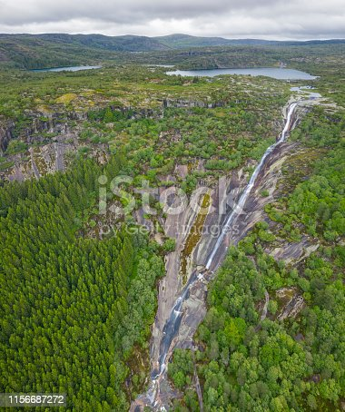 Aerial of the famous Skrelifallan Waterfall with a total length of over one kilometer which makes it one of the longest in the world. Skrelia, Lyngdal. Norway. Converted from RAW.