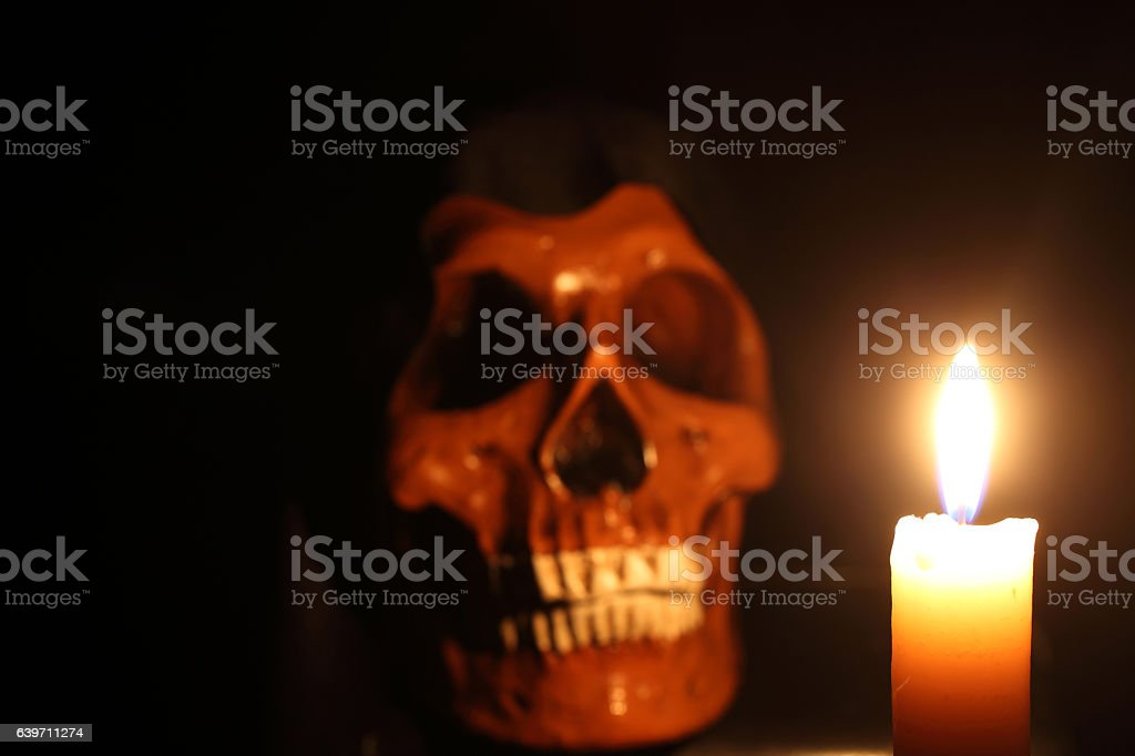 Skull and candle stock photo