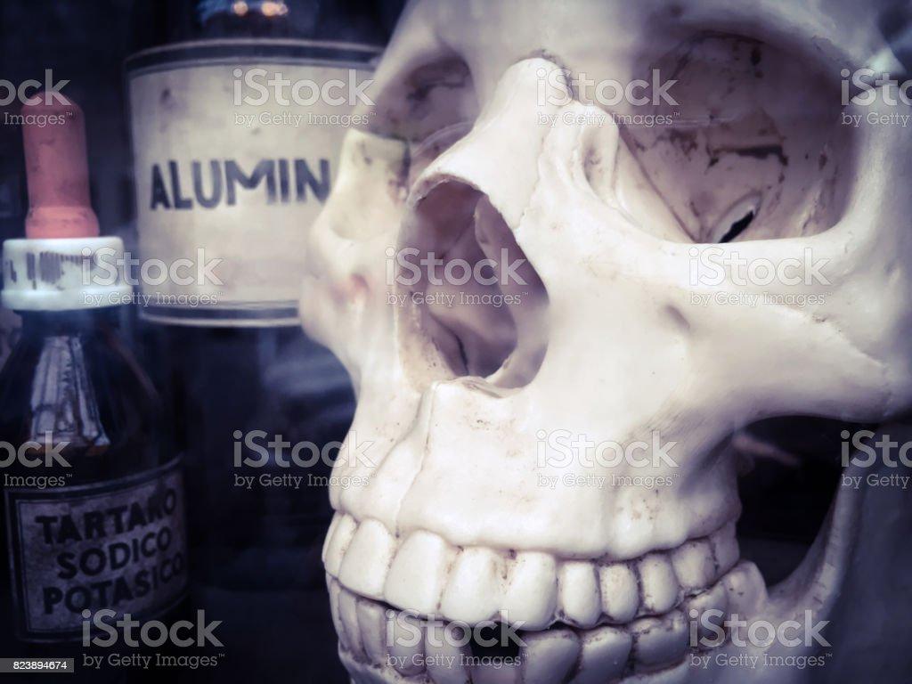Skull and vintage chemical bottles stock photo