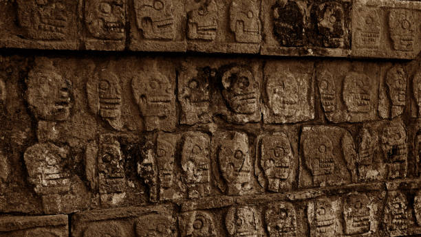 skull carving on a wall at Chichen Itza skull carving on a wall at Chichen Itza, mayan pyramid in Yucatan, naya rivera stock pictures, royalty-free photos & images