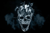 istock Skull from cigarette smoke on a black background. Creative background. The concept of smoking kills, nicatine poisons, cancer from smoking, stop smoking. Copy space. 1075915050