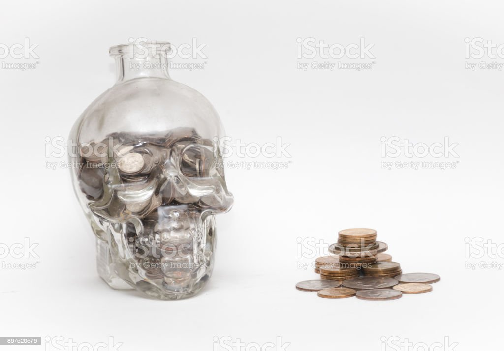 Skull Head Jar with Coins stock photo