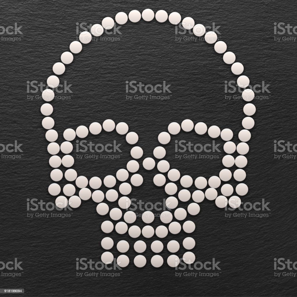 Skull Made out of White Pills stock photo