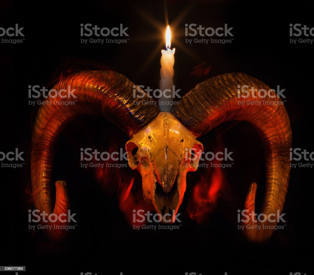 Skull of ram with lighted candle - Taro stock photo