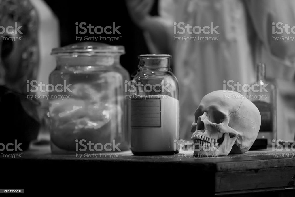 Skull on the table stock photo