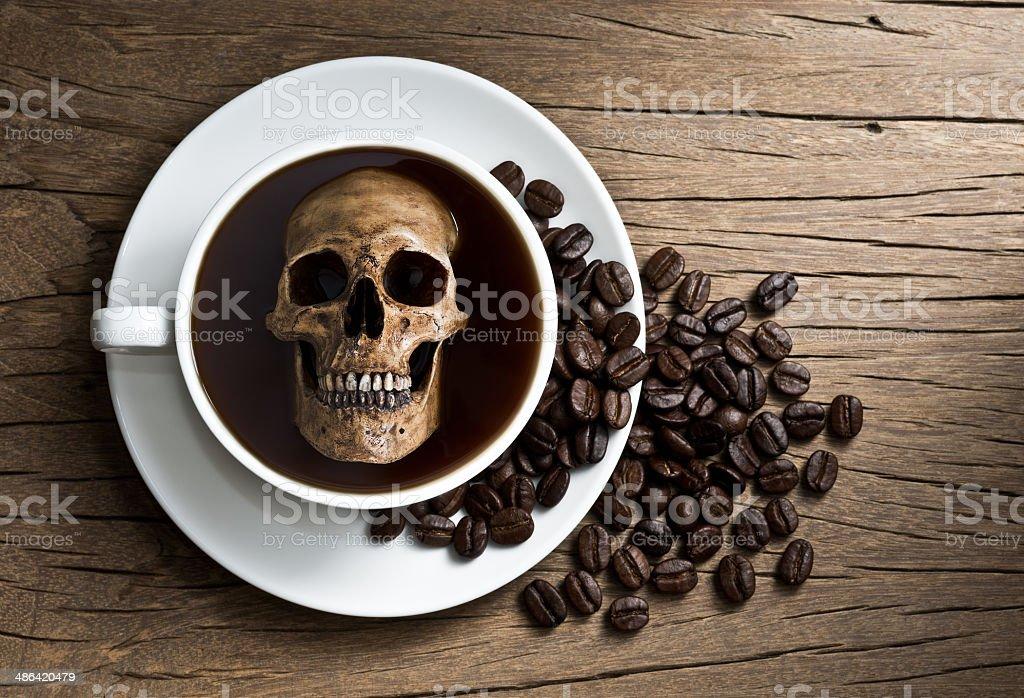 skull soak in coffee stock photo