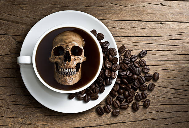 skull soak in coffee - coffe with death bildbanksfoton och bilder