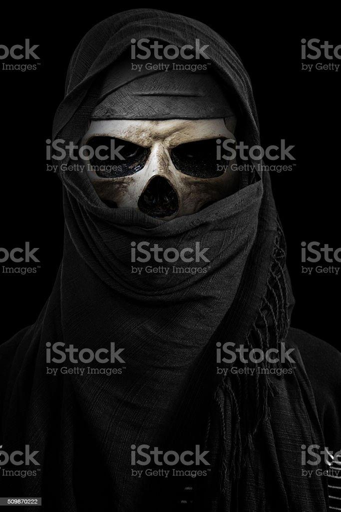 Skull under black veils, isolated on black background stock photo