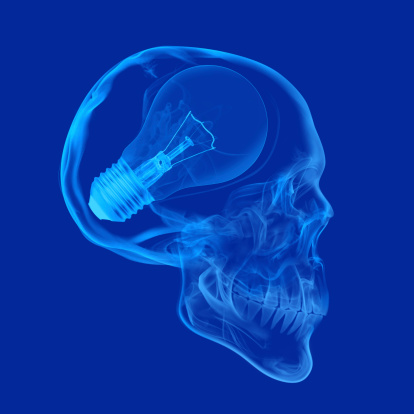 Skull With Light Bulb Stock Photo - Download Image Now