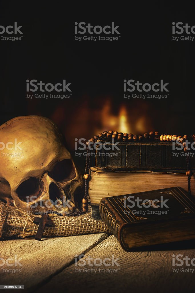 Skull with Rosary and Bible in front of a fireplace Rosary with Skull and Bible in front of a fireplace Aging Process Stock Photo