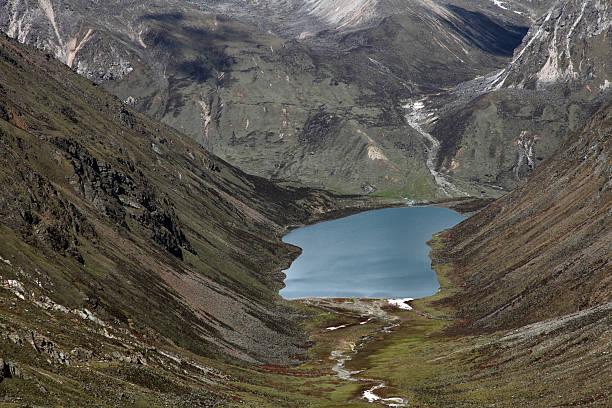 Skull-shaped Alpine Lake stock photo