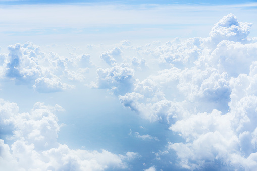 istock Sky above clouds with nice dramatic light. View from airplane window 1140149204