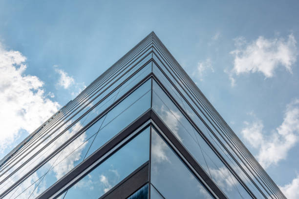 Sky and clouds reflected in modern building windows stock photo
