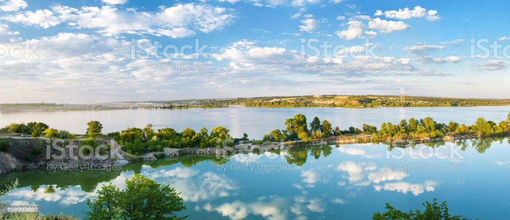 Sky and clouds reflected in water. Beautiful natural landscape. Panoramic view, Ukraine royalty-free stock photo