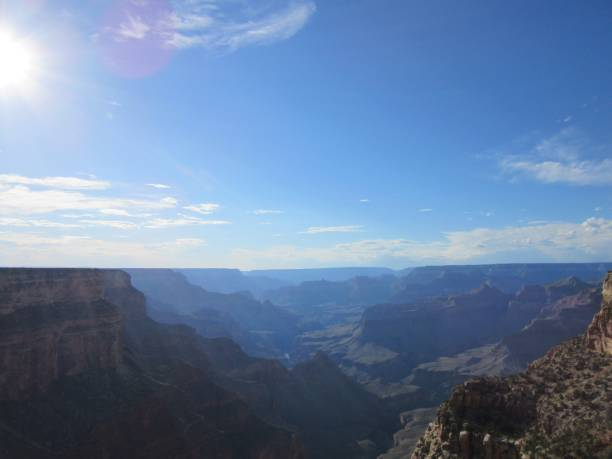 Sky and sun over the Grand Canyon stock photo